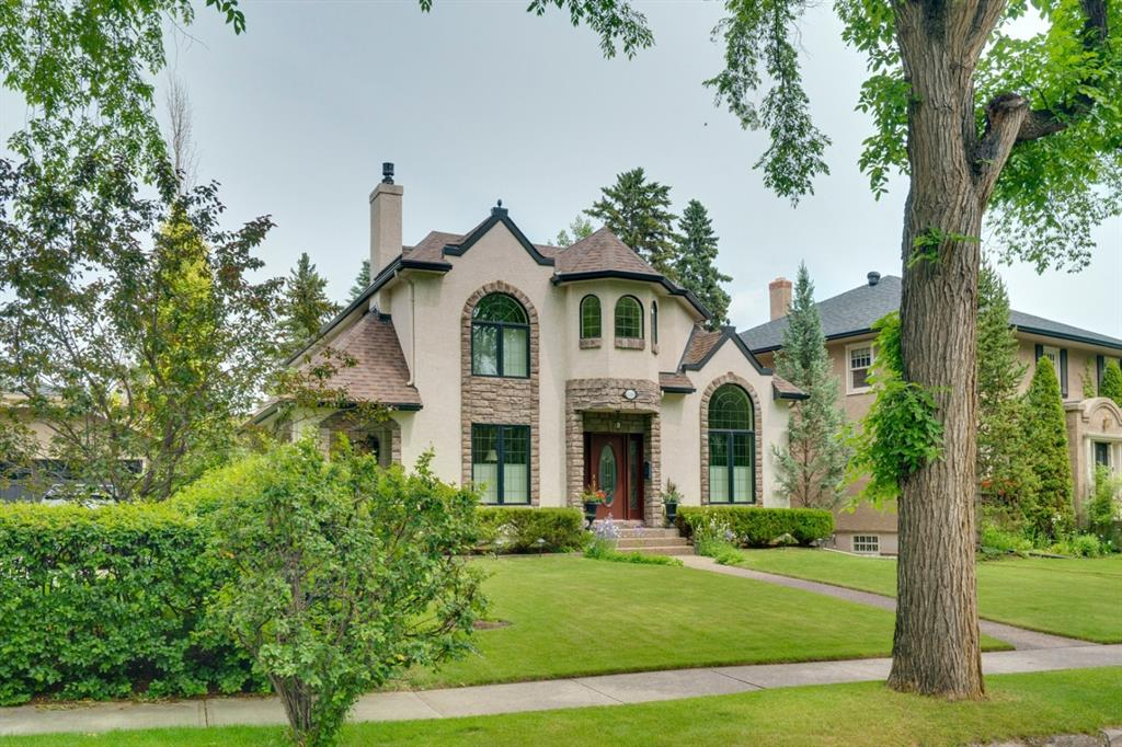 This beautiful executive family home was built from the foundation up in 2002 & is situated on prestigious Frontenac Avenue - on one of the most sought-after streets in Mount Royal. Featuring over 3805 sq. ft of elegant living space on 3 levels & 4+2 bedrooms, this is perfect home for any growing family! The welcoming foyer opens up a formal sitting area on the left with a stone surround gas fireplace & formal dining area with a vaulted ceiling to the right & leads through to the gourmet kitchen with dark cherry cabinetry, top of the line appliance package, granite counters, separate breakfast area & sides on the formal living room with gas fireplace surrounded with custom built-in shelving & French doors leading to the private side veranda. The main level also includes gleaming oak hardwood floors, office or bedroom, mudroom, laundry area & 2 piece main bath. At the top of the custom staircase is a spacious loft with large windows flanking the level with natural light, a wall of custom built-in bookshelves & overlooks the foyer. The 2nd level also hosts 3 bedrooms including the master retreat with spa-like 4 piece ensuite including a jetted tub & sperate shower. 2 additional bedrooms & 4 piece main bath complete this level. Down the stairs to the fully developed lower level, you will find an enormous family/recreation room with bar area & 2nd fridge, 2 bedrooms & 3 piece bath. Additional features include in-floor heating under all tiled areas, sound system on main & upper, a triple detached garage & new heating & air conditioning system & new shingles in 2020. Conveniently located close to all amenities such as The Glencoe Club, River Park, Elbow River Pathways, excellent schools, trendy Marda Loop & 17th Avenue.
