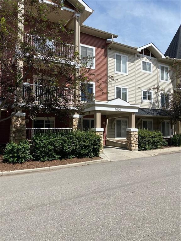 Exceptional VALUE for this BEAUTIFULLY UPDATED 2 br+den condo in desirable Panorama Hills. This well designed unit offers an OPEN and functional layout. Recently painted and newer flooring throughout. The kitchen features GRANITE countertops, plenty of cabinets and a breakfast bar overlooking the the dining area and living room. There?s a balcony off the living room. The master bedroom has a walk in closet and a full ENSUITE. The spacious second bedroom is on the opposite side. There is also a Den and titled UNDERGROUND parking and STORAGE. Fantastic LOCATION steps to superstore, Vivo Rec Centre, restaurants, banks, Landmark cinemas and more!