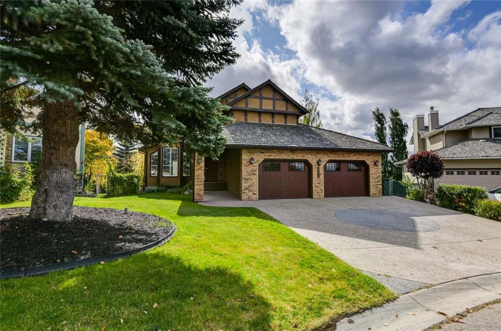 """Incredible fully developed 2500 square foot home with walkout basement on a spectacular large treed lot backing onto the Douglasdale Golf Course with mountain views! The lot could be a gardeners dream. This is a 4 bedroom plus loft 2 storey split home with a fully developed basement for a total of 3700 square feet of developed living space. Aggregate style coating and aluminum railings with glass panels on the full width deck plus patio off of the walk-out basement. Large 28'x28"""" double attached garage with two garage doors and built in shelving. Steam shower in basement bathroom. Central air conditioning, sprinkler system, granite countertops, shutters thruout, beautiful curved staircase plus hardwood floors. Beautiful raised garden area in the huge treed backyard located on a quiet cul-de-sac. Perfect setting for any family."""