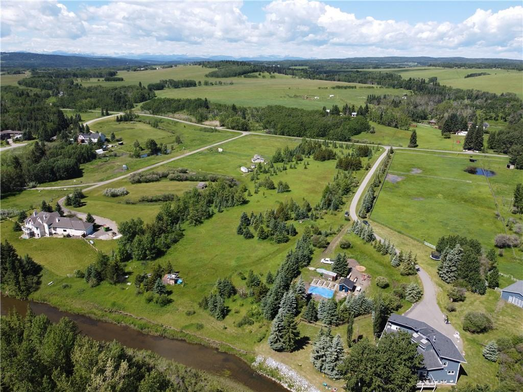 5.93 acres of beautifully treed land backing onto Fish Creek (the actual water). Only: 1.3 km North of HWY 22 on Priddis Valley Road; 13kms from the new intersection of the South Ring Road and 22X; 18 minute drive to Somerset C-Train Station; 10 minute drive to the new Costco at Tsuut'ina's regional retail and commercial centre. Paved road all the way to the land. No building commitment! Over 2000 trees planted by current owner. Power and gas to the property line. Excellent 32 gal/minute (when last tested) well. This property offers a quiet and private setting within an easy commute to Calgary.