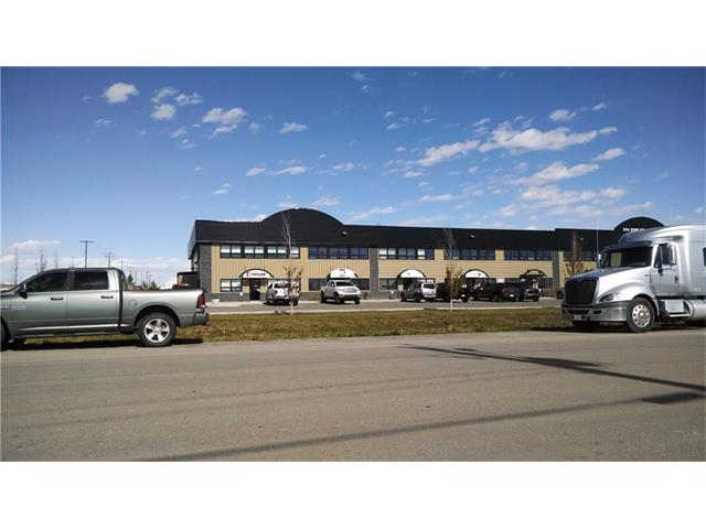 This conveniently  located industrial bay with access to Stoney and Glenmore Trail is well developed with front offices on the main and mezzanine floors with bathroom and kitchenette. The Bay itself has 22 FT CEILINGS, 16' doors and is currently approximately 1,300 FT of WAREHOUSE SPACE. The front reception and office area is around 750 sq.ft. The MEZZANINE ,which is also around 750 sq.ft, has a SEPARATE ENTRANCE at the FRONT DOOR for your convenience. The upstairs mezzanine has been developed as an office space with 3 rooms.Perfect set up for business owner and can be purchased with 10% down for qualified buyers.