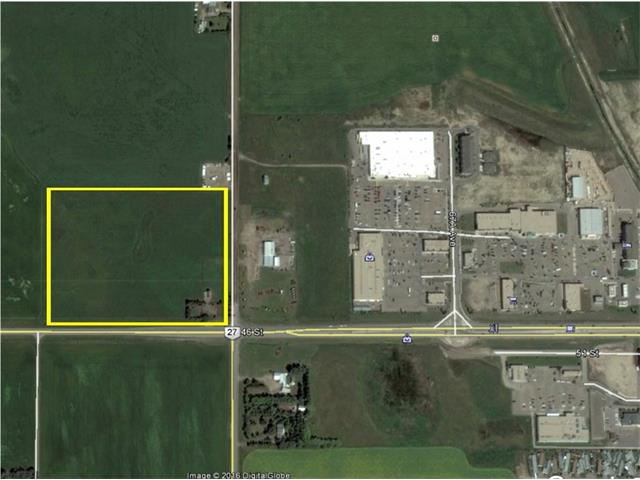Great site for development for this 20 acre site located on the edge of Olds. Presently zoned agriculture. Highway #27 Frontage Call today