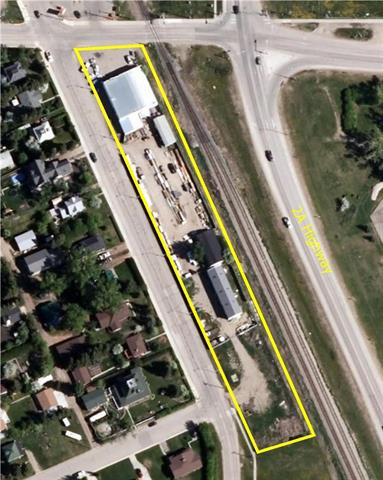 Great location on the corner of a high traffic area main building 6735 sq.ft, 42 x 64 qounset and 24 x 94 quonset, 22 x 54 shed all on 2.1 acres. Many possibilities
