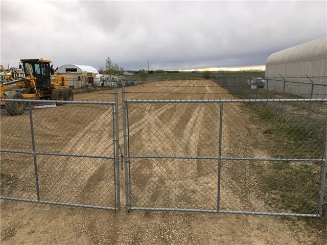 Excellent opportunity to own your own industrial lot in Carstairs. Thinking of expanding your business or simply need a place to store your equipment, building materials or construction equipment well here it is. This almost ½ acre vacant lot is fully fenced, freshly graded with new gravel and offers plenty of opportunity to build or simply provided outdoor storage. All services at the street.