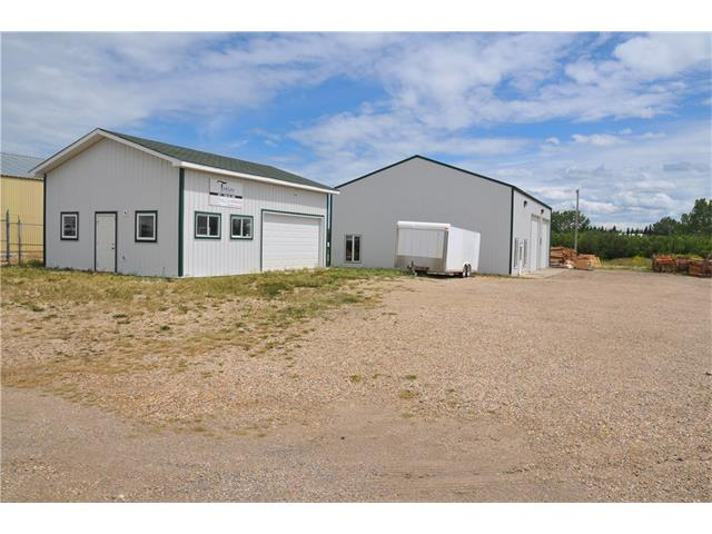 Newer 40x60 shop with 20x40 office area with another 20x20 upper mezzanine office area; two 2 piece bathrooms; in-floor heat throughout the shop; HVAC system for the shop area; Hot Water on Demand; Two 14 ft high x 16 wide doors; 24x32 heated garage is also on the property; 233ft x108ft commercial lot zoned arterial commercial; take a look at this excellent property.