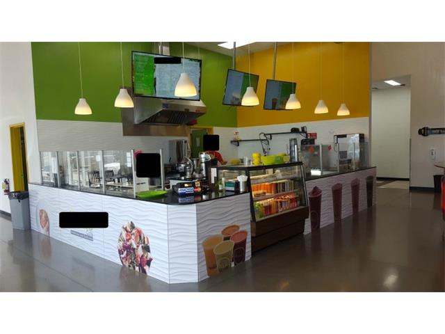 Rare Food business opportunity located adjacent to popular fitness gym.Located in a new industrial area in North Calgary close to large residential areas and new businesses.  This business was created in April, 2017 and was designed to offer healthy foods (salads, wraps, soups & sandwiches) , healthy  fruit & vegetable smoothies to fitness buffs, bodybuilders, and people conscious of eating healthy foods. To cater to other tastes they have added Shawarma  and pannini sandwiches.   Projected Monthly gross income between $18-$21k. With a projected monthly net income ranging from $ 5000-$ 7000/month. Business works with personal trainers to customize food plans for clients. Original cost  Equipment & Leaseholds Totalled $130,000. NOTE: Location is not actual.