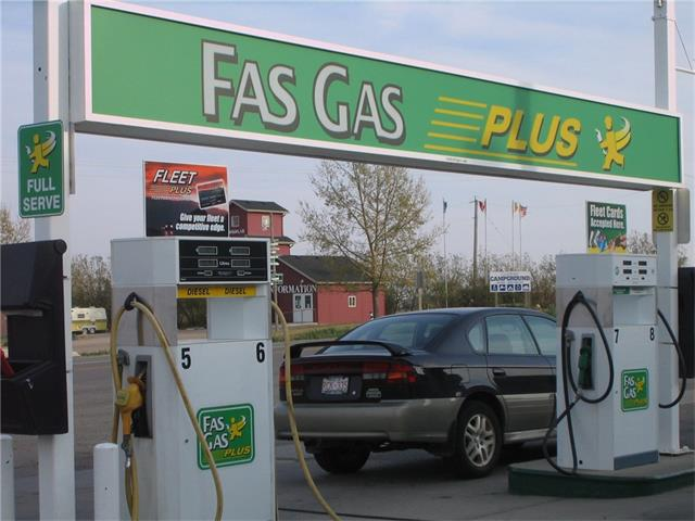 Fantastic opportunity to own a GAS STATION & CONVENICENCE STORE located in beautiful CARSTAIRS, AB, only 40 minutes north of Calgary. Currently operating as a FAS GAS offering Regular, Premium, Diesel fuel and Propane. This business includes LAND and BUILDING on a highly visible corner lot on HWY 2A, zoned I030 (Highway Commercial). Equipment includes 3 underground, fibreglass tanks (2-8,000 gallons 1-5,000 gallon), one above ground propane tank, 4 dual gas pumps with double nozzles. The convenience store equipment includes 5 washing machines, 8 dryers (commercial, coin-operated), NEW 5-door walk-in cooler, etc. Sales include fuel, cigarettes, confection, lottery sales. There is currently an empty bay next to the convenience store -ideal to rent, for owner use, to expand the convenience store, use as a lube or mechanic shop, or even a liquor store or garden centre (town approval required). Great client base with a mix of local residents and highway traffic. Great business with room to grow and improve!
