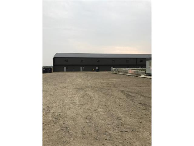 Industrial property with Hwy 582 frontage.This building sits on 3.310 fenced acres very close to the 4-way stop on the corner of Hwy 2A and Hwy 582.Excellent access for large delivery vehicles.This corner also leads into the Town of Didsbury, AB. Metal building w/ spray foamed insulation.Single phase 400-amp power.  8? high chain link fence around the property.Video surveillance in each bay and the yard.