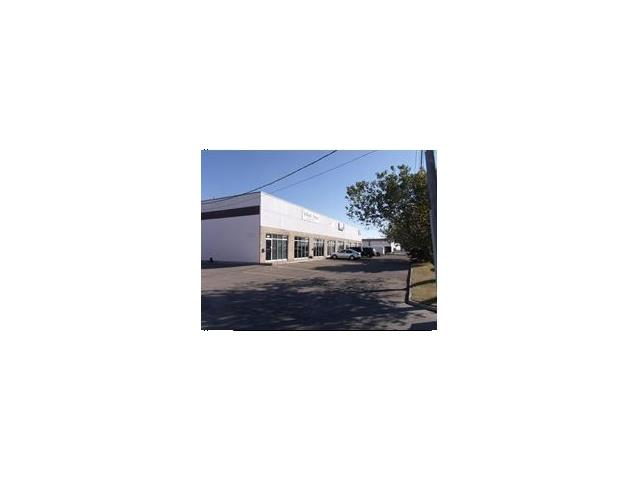 For Lease small industrial bay 2317 Sq. Ft. with offices up front and warehouse in the back, Drive in door.  929 Sq. Ft. off mezz level storage for free.  Nice space, easy to view.  Great bay facing Glenmore Trail with