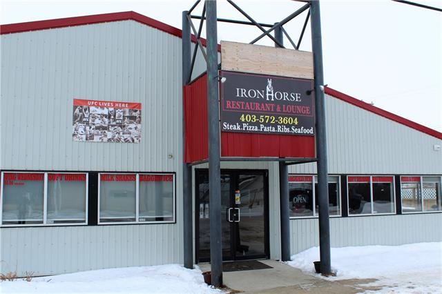 GREAT OPPORTUNITY to own this NEWLY RENOVATED & SUCCESSFUL full service, air conditioned, & licensed restaurant/pub in Carbon, AB.  The building sits on 3 commercially zoned lots & is almost 5000sq? with an XL fully equipped kitchen complete with walk-in cooler, walk-in freezer, & pizza oven.  There is also a laundry room and 3 separate washrooms for the men, ladies, & staff.  The pub side of the building has a large bar, various booths, 6 TV?s, billiards table & DJ booth.  The venue is used for all kinds of functions due to the size (capacity of 300) & amenities.  Live bands come and play on a monthly basis.  A full menu for breakfast, lunch, dinner, & pub-style foods.  The metal siding, new asphalt shingles, & new west-facing private outdoor patio area mean little exterior maintenance for years to come.  There is plenty of parking on site and on the street.  Due to little competition, the restaurant is great success currently grossing between $40K and $45K/month serving many communities in the area.
