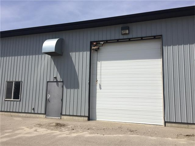 1200 sq ft Industrial Bay. 14 ft door, 17.5 ft ceiling height. Bay has washroom with sink, toilet & shower, office area, mezzanine & overhead heaters. 3 phase, 60 amp power. Lots of parking. Condo fee of $85/month includes exterior maintenance, snow removal & landscaping. GST is not included in price.
