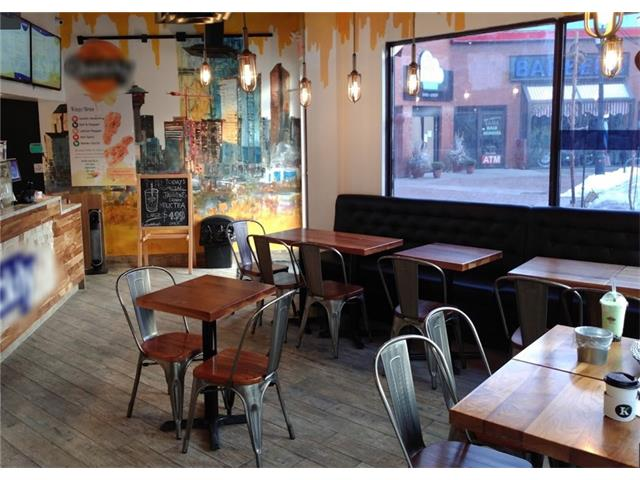 This is a beautifully decorated, very clean franchise juice & snack shop, located in the trendy busy Kensington area, lots of foot traffic, close to C-train station. Features 998 sf, 25 seating capacity, new commercial kitchen, low rent. It could be converted to other food service upon landlord approval. Great opportunity for family business. All viewing by appointment only. Thanks!