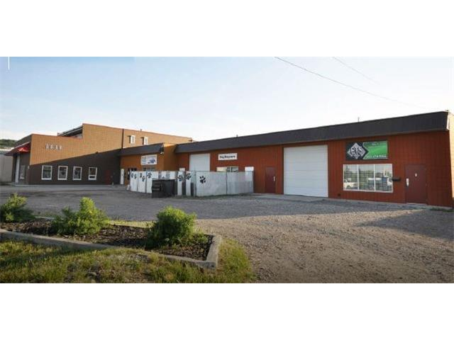 For Sale, Free Standing industrial Building in Northwest Calgary. Could be owner/user, Investment or combination, use some of the building for your business and lease out the other end of the building.  Includes two level office space/Mancave Suite.  Current rent from only part of the building is $129,600/Year.   5616 Sq. Ft. main floor office/shop and second Floor office area..  Just off Highway 1, beside Rona and Sunnyside Greenhouses.  Wide range of uses and lots of parking for staff and clients.  Leased area is 6,000 Sq. Ft. On .5 acres.