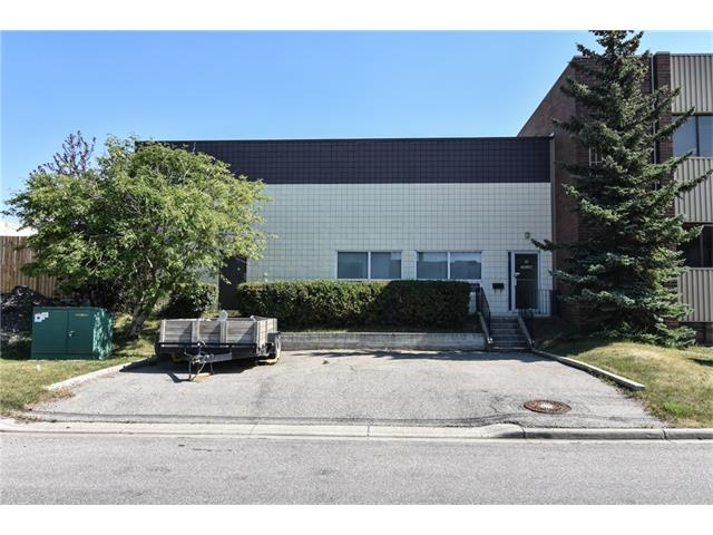 Here is a great opportunity to own your own freestanding building just off Deerfoot Trail and McKnight Blvd. 3778 sq. ft. interior space  / 3964 sq. ft. exterior measurement under one title divided into 2 bays each with their own drive in overhead doors. One side is vacant with office space at the front with mezzanine space above for light storage and the rest warehouse. The other bay is a woodworking shop with upgraded 200 amp electrical for equipment and machinery. New torched on roof 6 years ago and new glass in front windows September 2017. New overhead furnace in rented side mid November 2017. 3 parking stalls in the front and 4 more in front of the overhead doors at rear. New real property report with compliance July 2017.Same owner for over 35 years! Excellent for owner operated business. Great close in location in popular mixed use industrial area.