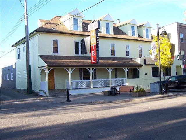 Opportunity to own a 3 story hotel facility with a gross area of 10, 696 sqft approx in core downtown area of Ponoka. The main floor is divided into a 145 Seat Tavern with a retail Mexican imports store. Tavern also has 1 ATM Machine and 5 VLTs machine. The second floor has 12 Guest rooms with almost 80% occupancy where most of the tenants are on monthly and weekly basis. Current over has recently painted the whole hotel and upgraded some amenities.  A Tour can be set up by an appointment.