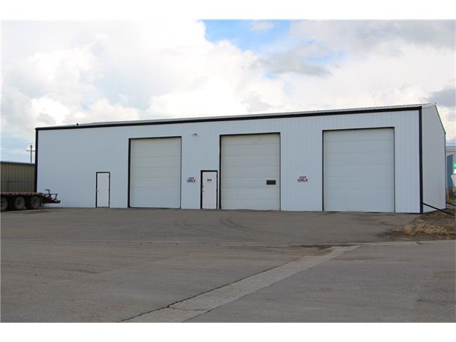3200 sq ft industrial building with 4 bays on 98 x 197 foot lot.16 foot ceiling, 12 x 14 overhead doors, 3 of the bays are wash bays. Price includes truck wash equipment.  The building has new siding and equipment is in excellent condition.