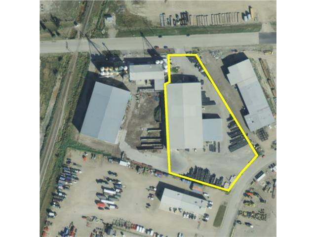 40,000 sq ft industrial building with a 7,200 sq. ft. attached building. 3-10 x 10 dock doors and 3- 18 x 26 drive through doors, 2,700 sq. ft. of office space, 3.5 acres of paved yard. The industrial space can be divided into smaller spaces. lots of possibilities. Great opportunity. Call Today.