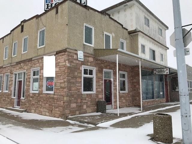 Steady and Stable Business with Property located 2.5 hours away from Calgary.  Business consists of busy sports bar with 4 VLTS, Off-site Liquor store and 10 Room Motel with sales close to $1 Million per year.  Property also has a 2,000 SF Residential living quarters above first floor with 5 bedrooms, 2 bathrooms, kitchen and Office with cameras, all this located in the heart of downtown. Easy to Operate with minimal staff (3 in total).  Local patrons enjoy the VLTs, TVs, pool table and snack foods.  Off-Site Liquor store has an impressive liquor selection, with extra storage/cold rooms for inventory. Renovate the remainder of the Motel rooms and Restaurant space to increase cash flow. Live upstairs and operate the business at your leisure.