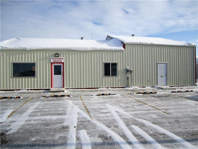 LIGHT INDUSTRIAL SHOP. 40' x 60', 2400 sq. ft with in floor heat. Metal exterior. Shop area is 24' x 40' with two overhead doors - 10' x 12' & 8' x 10', 1 man door and also features electric/hydraulic in floor scissor lift platform. The retail/reception area features 2 offices, coffee room, storage area, two - 2 piece bathrooms, mechanical room plus 3 man doors. The floor and walls have been completely repainted. A  30' x 50' mega dome and approximately a 1/4 acre fenced.  Lease rate is $3500.00/month plus tenant pays all utilities and content insurance.