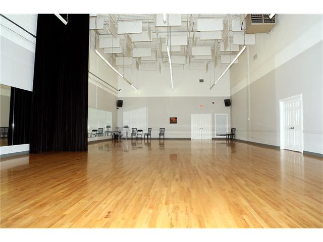 8192 Sq Ft currently used as a dance studio. 25' ceilings, 2 drive in doors at rear. 100 amps - sub-leasing can be considered.