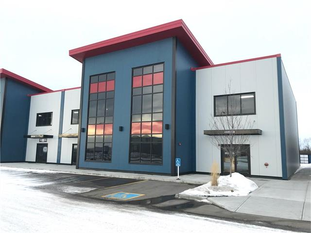 Brand new industrial office/warehouse condo unit in Airdrie's Gateway Business Park. Available size 2200 sq ft. Average Operating Costs $6.50 PSF Incl: owner's insurance, property taxes, exterior maintenance, garbage removal, snow removal and grass cutting. The Paved Parking is first come first serve and illuminated. Overhead doors 12 x 15. Parking: Interior Height of building: approx. 22-25 ft. Site: The building was designed for second floor or mezzanine development. The signage can be located on the front storefronts or illuminated 3D above the front entry metal framing. DC-27-A Zoning offers many different business opportunities within the complex.