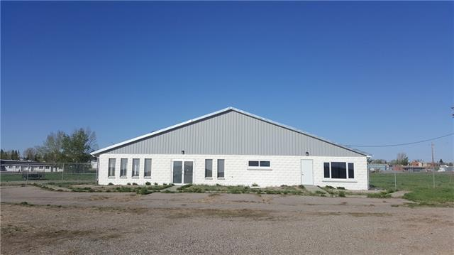 Looking for a location for your business with highway exposure? This could be the place for you! This property is located in the Town of Vulcan, along Highway #23, almost half way between Calgary and Lethbridge. This property includes a large fenced lot, 3.95 acres, and a recently renovated building with office space, shop and storage, approximately 4,636 square feet in size.  This property has 220 AMP electrical service. This property is zoned Highway Commercial - C-2.  Note:  This property was once a gas station.  The property was remediated.  Since then, there was a test done in January 2017, and there were tests done and in some of the test holes, contamination was found.  The owner has since had an estimate for remediation.  For more information, contact the listing agent.