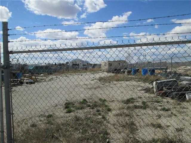 A great chain link fenced and level 55' X 160' C-1 lot for your business or storage, located in the Carstairs light industrial area. Paved street, power to the lot, 3 Phase Power at the property line, water and sewer at the property line. The zoning does allow for ZERO lot line construction. Sellers have a clean Phase 1 Environmental study.