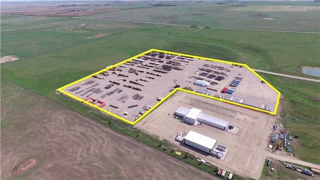 20 acre mod yard with a 5,000 sq.ft. modular office  available for lease. Located on a high load corridor. Fenced and heavily packed gravel base able to hold 200 tonne. Heavy power at site. also available 11,220 sq.ft. crane building with 25 ton crane. Located East Balzac. Call Don for more details