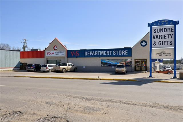 Super Location at the corner of Centre Street North and Hwy 22. Pylon signage, highly visible and plenty of parking at this very busy intersection. Over 6100 square feet of retail space with two washrooms, storage area and an office.  SELLER WILLING TO ENTERTAIN OFFERS TO LEASE - 3 SEPARATE BAYS ARE AVAILABLE.