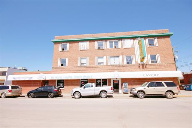 3-storey freestanding hotel only 50 minutes from Calgary. Opportunity for an established business that has a variety of income stream. Starting with 50 seat restaurant that has a room dedicated to holding small functions, leased out for $45,000/year, 190 seat pub with 7 VLT, 30 room motel, All in good condition. The top 2 floors have 30 rooms and a 2-bdrm manager's suite. The hotel current has 20 rooms leased by monthly tenant. No experience necessary, great family business. All viewings by appointment. Please do not approach the staff without the appointment. Thank you.