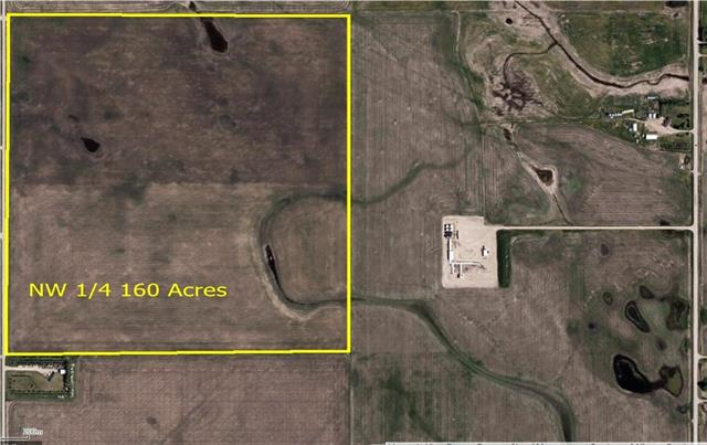 Great investment property located beside the town of Carstairs. 160 acres in 2 titles of 80 acres a piece, presently being farmed. Generating Approximatley$15,000 in annual income Excellent development site Adjoining land and buildings also available.