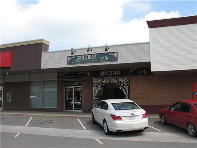 Retail lease space is 2597 sq.ft. is located in Uptowne Olds . Property is ideal for business that will benefit from easily-accessible walk-in traffic. This property has been home to a fine ladies wear business for over 30 years with attractive front display windows to feature new merchandise. The space includes a well-appointed show room with change rooms, a rear service area with two 2 piece bathrooms, two offices, and secure storage. Newly installed street lighting and flared sidewalks encourage spending extra time in the active central business section. Parking includes 2 stalls in rear, shared mall parking lot to north, front street angle parking on main street and town parking lot within short walk for buses and large units. The mall has access to O-Net a high speed fiber optic broadband network that is currently rated the fastest service in Canada, with 1000 megabit per secondinternet , television and toll free long distance. The space is a triple net lease at $2597/month plus common area costs.