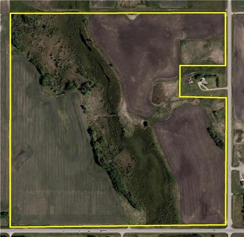 Great location on highway 27 west of Olds. 151.31 acres. 90 acres cultivated, balance pasture and creek
