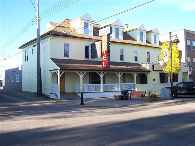 Opportunity to own a three story hotel with a gross area of  approximately 10,696 Sq. Located in the downtown core of  Ponoka which is located 2 hours from Calgary and just under one hour from Edmonton.  The main floor consists of the Chipman Avenue Saloon with 1 ATM, 5VLTS and is licensed to seat 145 people.  It has been updated and renovated. A main floor retail space is currently being operated as a Mexican Import Store. The space originally was a liquor outlet, and is still licensed to be that if new owners so wish.  The second floor has 12 guest rooms that are 95% full with monthly based tenants. The third floor is currently empty but could be rented out.