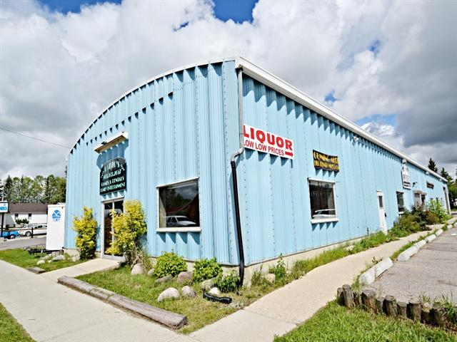 Super opportunity to rent a large commercial space in the heart of Turner Valley. Across the street from Eau Claire Distillery, this high profile building with retail frontage is offering 2659 sq ft for $2000/month. Some permitted uses are Studio/Child Care facility/Retail/Convenience store/Clinic, a full list is available in the attached supplements. This bright space offers high ceilings, new bathroom, washer/dryer hookups,two storage areas and a janitors room. New tenant is responsible for any improvements and utilities. The landlord is offering fantastic incentive, first three months of tenancy at HALF PRICE!! The vacant lot next door (25'x188') can be leased in conjunction with this space for an extra $400/mth. Lots of parking available.