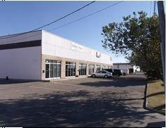 For Lease at $11.75 per Sq. Ft. per year small Industrial Bay east of Chinook Centre in Manchester Industrial Park.  Renovated and very clean this attractive bay faces Glenmore Trail and easy access to main roads.  Two private offices up front with reception area and 2 washrooms.  BONUS 731 SQ FT MEZZ LEVEL NO CHARGE.  Nice unit easy to view. Drive in overhead door.