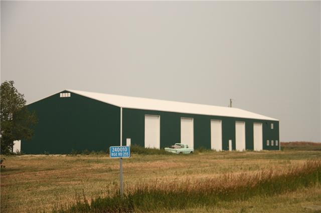 Engineered pole structure shop.  12000 sq. ft. with seven 14'x18' overhead doors and 5 man doors.  1800 sq. ft. mezzanine. Gravel floor. Heated with overhead heaters. 200 Amp 3-phase power.  Conveniently located 5 minutes SW of Strathmore. South of Strathmore on Highway 817 to Township Road 240 (Global Training Road) and west to Range Road 255.  Shop is visible from roadway.