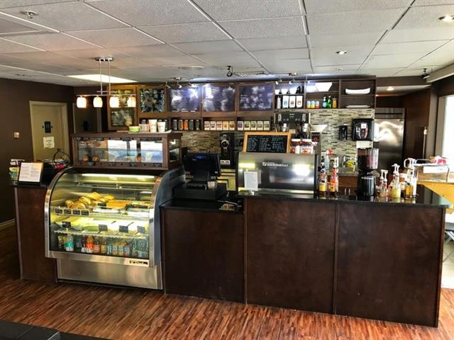 Coffee shop is located at corner of road and street in downtown core. Many walking customers around building from offices and apartment residents. Very low rent which includes everything. Good potential. Could be changed to a new concept business.