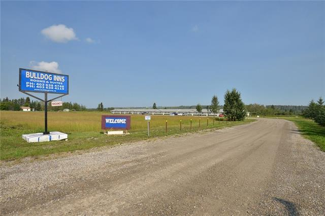 Attention Investors, Land Developers, and/or Business Owners!! Don't miss out on this prime piece of commercial land with a well established operating motel with 24 rooms, on the very busy intersection of Highway 27 and Highway 22.  This lot and motel are perfect to run 'as is' or to develop it for increased future business.  There is HUGE potential for greater profit returns!  It has live in quarters enabling you to both live and work at your new business.  In addition to servicing tourists, this motel houses many clients from both the Oil & Gas and the Forestry industries.  These three industries serve as the base for consistent income to this business and the community. Traffic count on this corner are over 17,100 vehicles per day and jumps to 19,300 per day from May to September! Sundre is a proactive business oriented community with a diverse economy.  There is strong intent on attracting new business to the town. Their #1 priority is to ensure healthy and competitive business within the community.