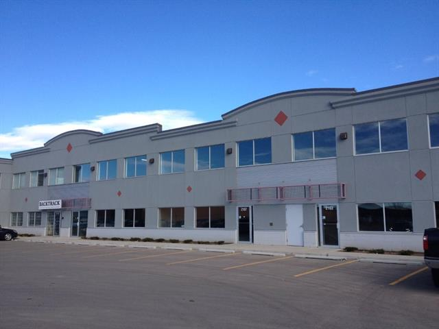 4,275 Sq.Ft. floor plan in shell condition with 1,002 Sq.Ft. of concrete mezzanine built. Great opportunity for the company that requires a showroom and office space in addition to warehousing. Large marshalling area behind the bay.