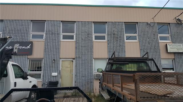 Industrial Bay with a main floor area of 2305 sf plus a messanine area of 745st, condo fee includes gas and water.