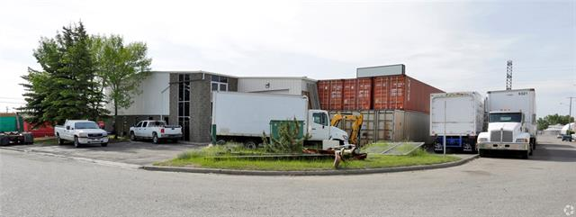 For Sale Industrial Building in Bonnybrook on .6 Acres  Small office space with 3 private offices Heavy Power drive through overhead doors, make up air unit, sump.  Great access to Ogden Road.  Easy to tour