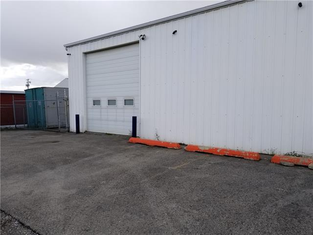 GREAT OPPORTUNITY TO LEASE THIS 1700 SQ FOOT BAY. WITH AN ADDED BONUS OF OUTDOOR STORAGE WITH A 300 SQ FT C-CAN. LARGE SPACE WITH WASHROOM ,12X 14 FOOT OVER HEAD DOOR AND A MAN DOOR TO THE FRONT OFFICE. 100 AMP SERVICE WITH 240 UPGRADE. CLOSE TO MAJOR TRAFFIC ROUTES.. NEW FURNACE AND WINDOWS. THE OTHER HALF OF THE BUILDING CAN BE AVAILABE TO GIVE YOU A TOTAL OF 3400 SQUARE FEET