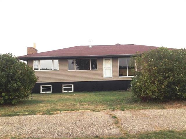 $4,000.00 Per Month NET included House and 29.96 Acres of Land. Zoned INDUSTRIAL GENERAL(Light to Medium Industrial and Compatible Commercial use) with ONE HALF MILE of FRONTAGE on TRANS CANADA HIGHWAY with DIRECT ACCESS.EXTENSIVELY renovated large raised Bungalow with 24x24 attached garage  can be used as a residence or an office.24x50 FT.Barn,Mobile Home 42x11FT. plus numerous out buildings.NEW well in 2015 with  in well technology (Pump and Pressure Tank Down Hole).