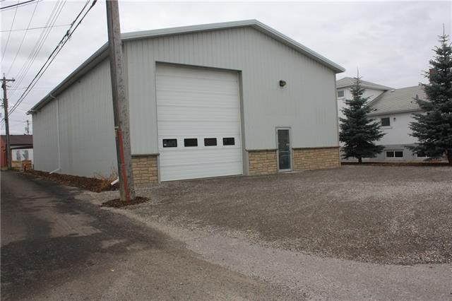 This 40 x 80 shop with 14 x 16 overhead door is located in the Uptowne Olds Core and is perfect for a variety of commercial uses. The entry has a wonderful lobby/receptionist area that leads into the shop. Inside you'll find another large office, a 2 pc washroom and a large overhead mezzanine. The shop is equipped with overhead radiant heaters, work bench side lighting, and airlines ran around 3 sides.