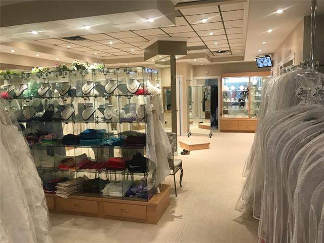 Established and well known Bridal wear, Formal wear and evening wear business catering to Calgary for the last 30 years.  Currently providing a comfortable shopping experience combined with superior customer service.  This beautiful business is a main floor retail space (2,161SF) located in a busy plaza with great exposure facing thousands of passing cars daily on MacLeod Trail.  Bright and warm atmosphere offering lots of selection in store, custom colors and catalogue ordering.  Great boutique layout with central studio, seamstress room, staff room and a total of 7 fitting rooms, one at front of business and 6 at rear.