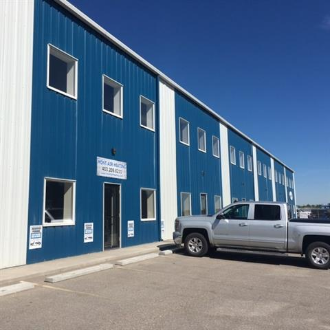 Easy access to Glenmore and Stroney Trail. Industrial Bay 1800 sq.ft and second floor office 900 sq.ft.