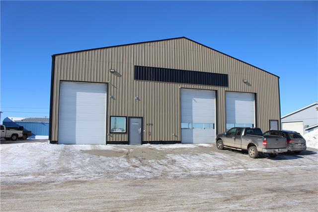 6912 sqft of space! There are 3-16 ft over head doors, office space, 2pc washroom, floor drain with clean put, 220v wiring, mezzanine level, water taps, located along highway 2A for great exposure for a business or easy access to highway 2. Common area outside is paved, lots of parking, lots of room to maneuver around.