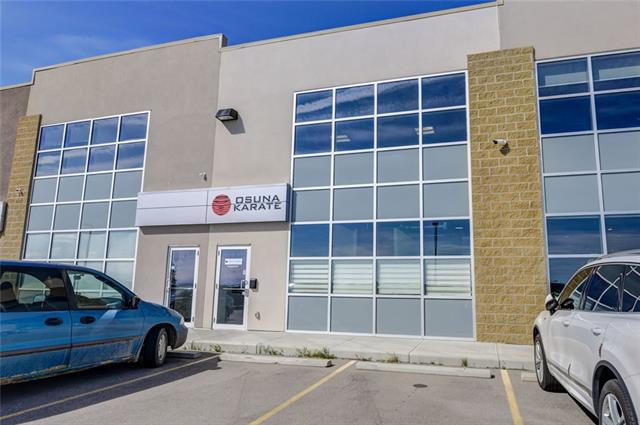FOR LEASE - Springbank industrial space 2400+ sq ft currently used as a fitness centre complete with male & female washrooms & showers, laundry. One drive in bay door, over 20' ceilings. There is a fenced outside storage. Quick access to TransCanada Hwy, just minutes to COP & Springbank airport. Also available for Sale (C4266625) call agent for more information.