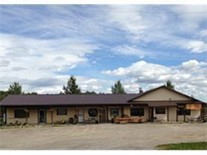 Great Location at the intersection of Hwy 579 & Rge Rd 52 in Water Valley. The Outpost Mall features 4 separate units on a 1.85 Acre lot with tons of parking. Water Valley is a beautiful location that attract Calgary & Cochrane commuting professionals, visitors out for a drive, golfers from the nearby Water Valley Golf Course and those who take advantage of the many recreational activities in the Water Valley Area.  This prime commercial property has three (3) 500 sq. ft bay as well as the operating Restaurant with each having its own gas and electric meters.  Exposure is great with everyone stopping at the busy 4 way stop in the middle of town.  There are two tank & field septics systems and water well service.  The metal roof is newer, stucco siding on the building and a covered boardwalk. Water Valley is approximately one hour northwest of Calgary in the foothills all on paved roads.